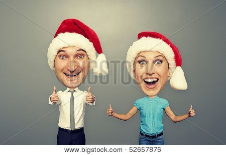funny christmas picture of happy bighead couple over grey background