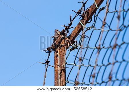 Rusty Old Fences Of Barb Wire