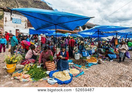 PISAC, PERU - JULY 14: people in the Pisac Market in the peruvian Andes at Pisac Peru on july 14th, 2013. Pisac is well known for its market which attracts heavy tourist traffic from nearby Cusco