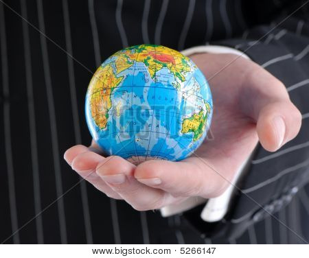 Businessman And Globe