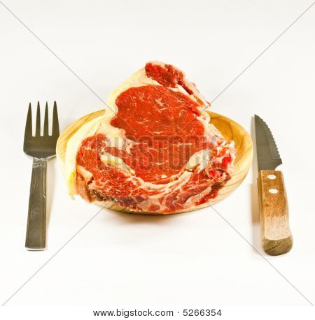 Meat On Wood With Knife And Possesor