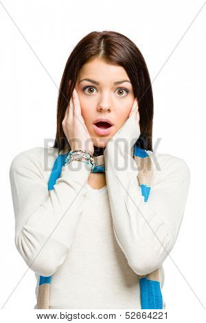 Teenager with mouth opened puts hands on head because of  unsolvable problems, isolated on white