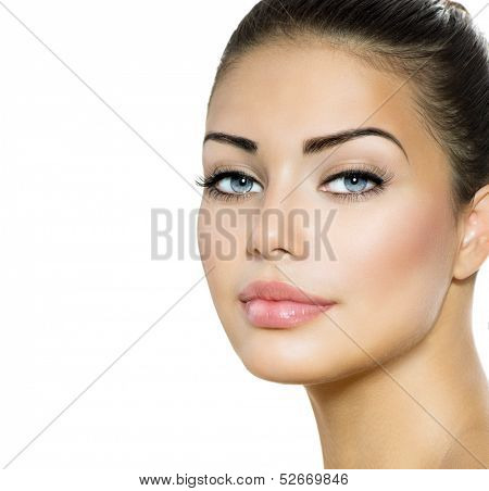 Beauty Woman Portrait. Beautiful Brunette with Blue Eyes. Perfect Fresh Skin. Isolated on White Background