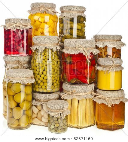 Collection of many glass bottles with preserved food isolated on white background
