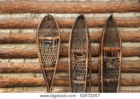 Snow Shoes And A Log Cabin