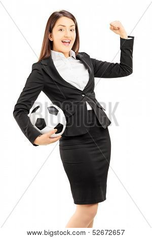 Euphoric businesswoman holding a soccer ball and gesturing happiness isolated on white background