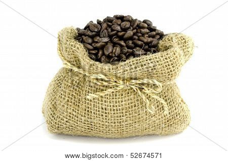 Coffee Bean In Gunny Bag With White Isolate Background