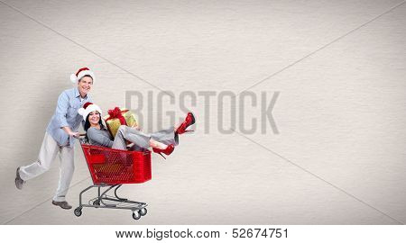 Running people with shopping cart. Christmas sale