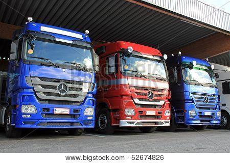 Row Of Mercedes-benz Actros Trucks In Carport