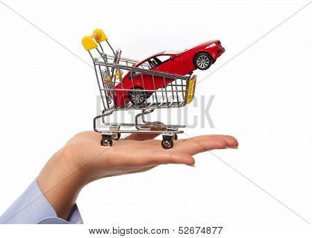 New car in shopping cart. Auto dealership concept background.
