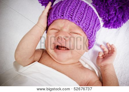 crying baby on white