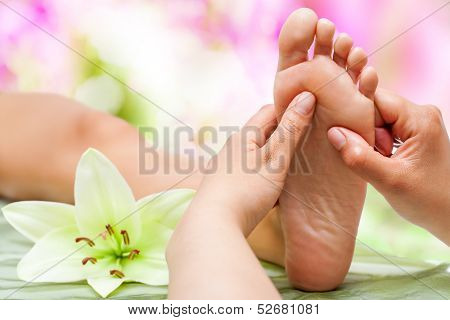 Therapist Hands Massaging Foot.