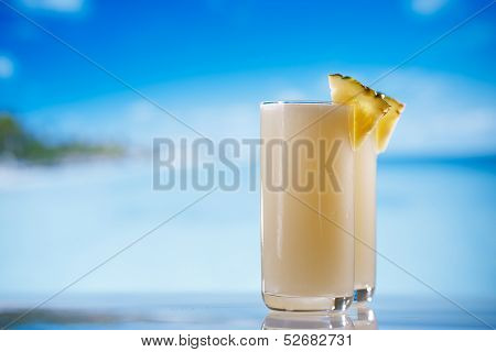 pinacolada pina colada cocktail on beach