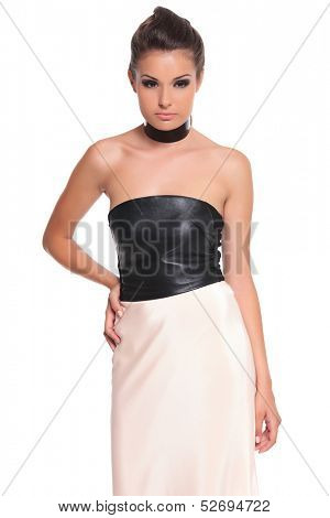 youns sexy woman in a dress standing with hand on hip on white background
