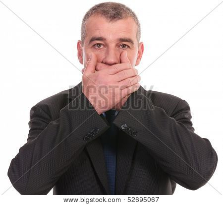 business man covering his mouth while looking into the camera. on a white background