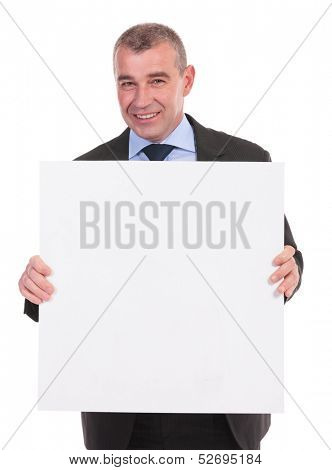 business man smiling for the camera while holding a small square pannel with both hands. on a white background