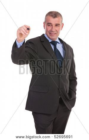 business man writing something on an imaginary screen while holding a hand in his pocket. on a white background