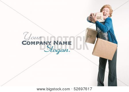 Overwhelmed senior woman trying to hold on to falling parcels