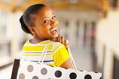 stock photo of mall  - cheerful african young lady in shopping mall - JPG
