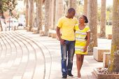picture of afro  - cheerful young afro american couple walking on urban street - JPG