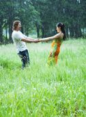 stock photo of dancing rain  - Lovely couple dancing in heavy summer rain