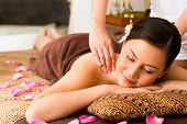 stock photo of ayurveda  - Chinese Asian woman in wellness beauty spa having aroma therapy massage with essential oil - JPG