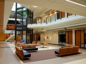 picture of commercial building  - Atrium of a modern building with furniture and tables - JPG