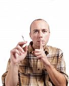 picture of sneaky  - A man gestures to not tell on him while caught smoking a joint - JPG