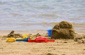foto of summer fun  - summer fun building sand castle on beach - JPG