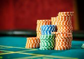 stock photo of roulette table  - Close up shot of piles of chips on the roulette table - JPG