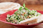 picture of pita  - Gourmet Middle Eastern salad Tabbouleh with pita bread - JPG