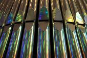picture of pipe organ  - the front view of silver organ pipes.