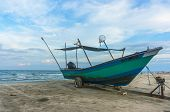picture of carron  - Traditional Fisherman Wooden Boat with blue skies - JPG