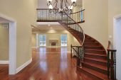 stock photo of entryway  - Cherry wood foyer with balcony and curved staircase  - JPG