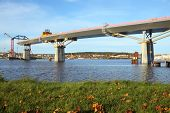 picture of flatboat  - bridge crossing the bay are almost complete - JPG