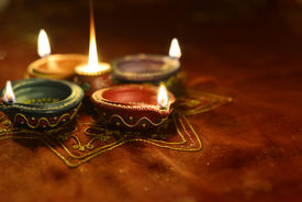picture of diya  - A group of decorative Indian Diwali lamps - JPG