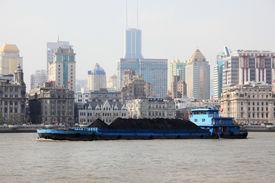 stock photo of coal barge  - Barge on the Huangpu river in Shanghai China - JPG