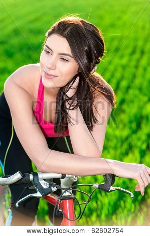 Sunset portrait of woman and on bike