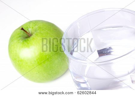 Glass With Water And Green Apple
