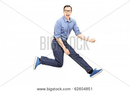 Young man doing an air guitar jump isolated on white background