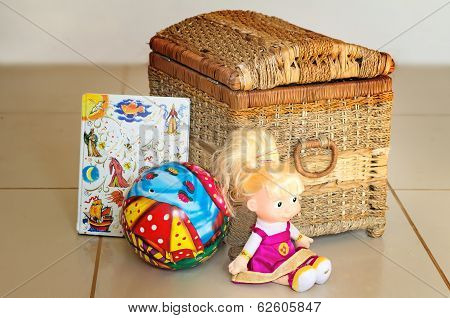 Children's toys and the container for their storage.