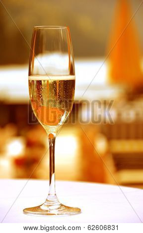 Golden champagne glass outdoor at sunset