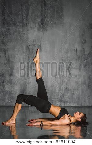 young beautiful sporty woman posing on studio background