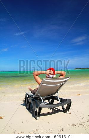 Man In Santa Hat On Chaise Longue