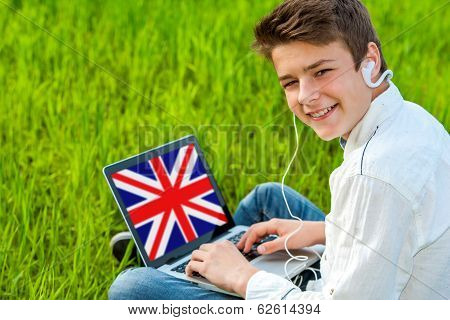 Teen Learning English On Laptop Outdoors.