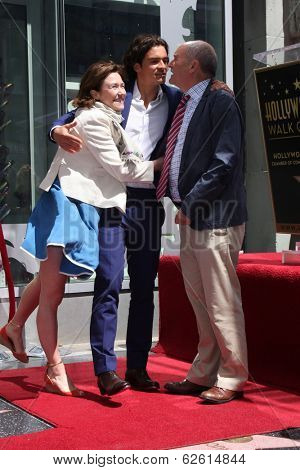 LOS ANGELES - APR 2:  Samantha Bloom, Orlando Bloom, Colin Stone at the Orlando Bloom Hollywood Walk of Fame Star Ceremony at TCL Chinese Theater on April 2, 2014 in Los Angeles, CA