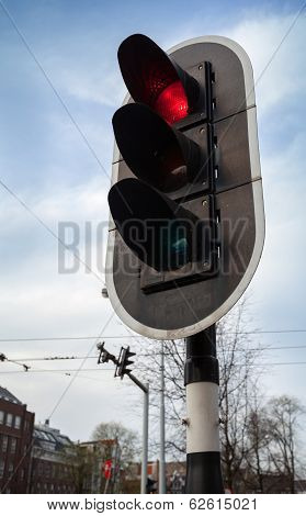 Red Stop Signal On Black Urban Traffic Light In Amsterdam