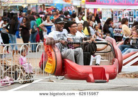 Family Rides Scrambler Carnival Ride At Atlanta Fair