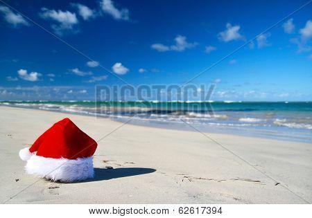 Santa Claus Hat On Caribbean Beach