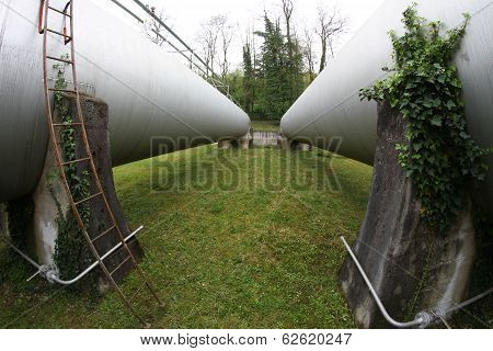 Long Tanks In Industrial Plant Outside Of The Factory